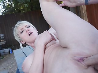 Milf makes good use of his big blarney outdoors