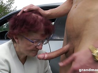 Sjort haired redhead granny gives a sloppy blowjob POV in a auto