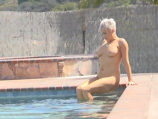 Ryan exposes their way huge tits and takes a naked sag in the pool
