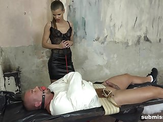 BDSM torture about a helpless male slave and dominant Sarah Kay