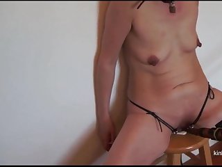 My wife rubs her pussy at bottom the bullocks prod at bottom a stool.