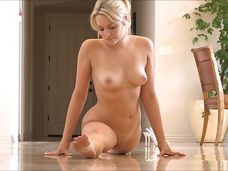 Changeable blondie loves playing with her pussy beyond the floor